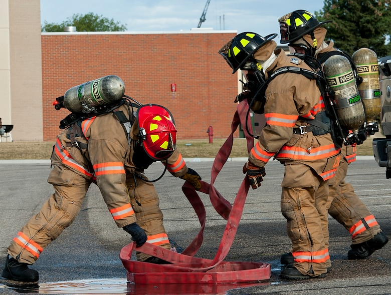 5th Civil Engineer Squadron firefighters work together to contain a simulated fuel spill during a training exercise at Minot Air Force Base, N.D., Sept. 8, 2016. The fuel spill was part of an annual training requirement and the entire process can take from only a few hours up to an entire day to complete, depending on how bad the spill is. (U.S. Air Force photo/Airman 1st Class Jonathan McElderry)