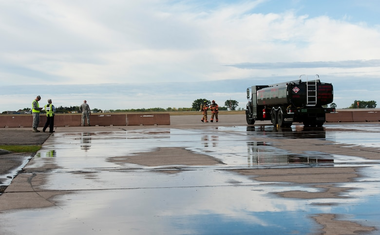 5th Civil Engineer Squadron firefighters begin training during a fuel spill exercise at Minot Air Force Base, N.D., Sept. 8, 2016. The exercise simulated a fuel truck spilling 6,000 gallons of fuel after its rear end got damaged, which was part of the annual training. (U.S. Air Force photo/Airman 1st Class Jonathan McElderry)