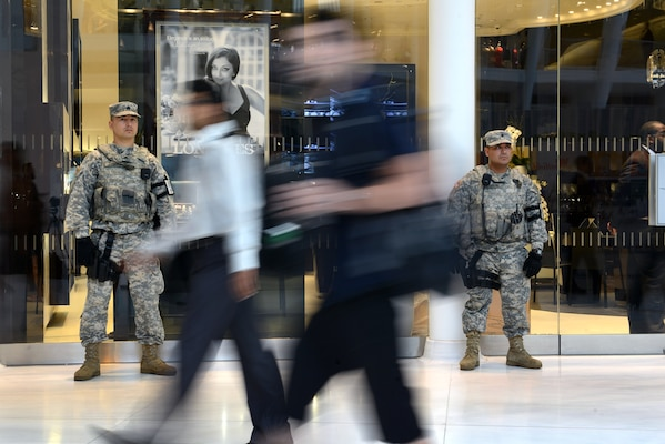 Sgt. Erislav J. Astanov, left, and Spc. Saul Revatta, both part of the New York National Guard's Joint Task Force Empire Shield, stand guard in a shopping mall and commuter hub at the World Trade Center complex in New York City. The  mission of JTF Empire Shield is to detect and deter terrorism— a mission they've been carrying out since Sept. 11, 2001. (Photo by C. Todd Lopez)