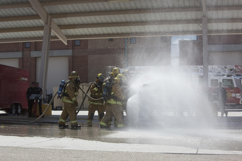 Combat Center firefighters extinguish a simulated propane fire at the fire station aboard the Marine Corps Air Ground Combat Center, Twentynine Palms, Calif., Aug. 26, 2016. (Official Marine Corps photo by Cpl. Thomas Mudd/Released)