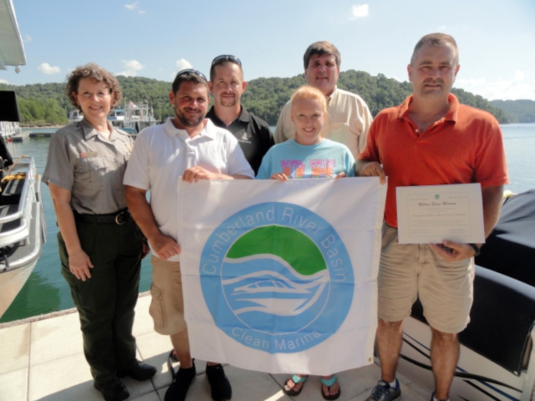 U.S. Army Corps of Engineers Nashville District officials present the Clean Marina flag to Darren Shell, owner of Willow Grove Marina, and his staff during a ceremony at the marina Aug. 26, 2016.