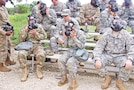 Cadet Victoria Tobitt, center, from Texas A&M University, Texas, sizes her mask alongside Fort Riley Soldiers for training Aug. 24 at the CS chamber. Tobitt said she has enjoyed being a part of the Cadet Troop Leadership Training program at Fort Riley and wishes all ROTC cadets could participate.