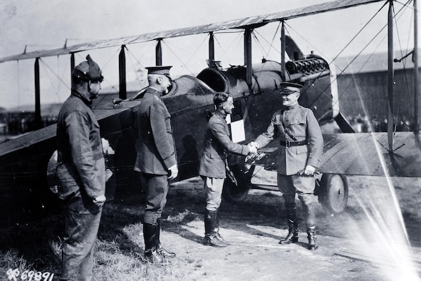 The pioneering 1920 Alaska Flight was an incredible feat of airmanship.  Air Service aircrews flew four DH-4Bs a total of 9,000 miles without loss of personnel or aircraft.  Here General Pershing congratulates Capt St. Clair Streett, the flight commander, upon his safe return.