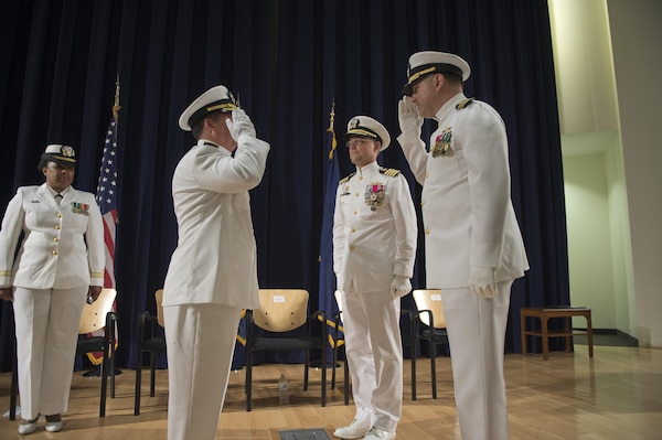 Capt. Mark Vandroff assumes the position of commanding officer relieving Capt. Rich Blank at Naval Surface Warfare Center, Carderock Division during the change of command ceremony in West Bethesda, Sept. 8, 2016. From left: Lt. Christilene Whalen, command chaplain, Naval Support Activity Bethesda; Rear Adm. Tom Druggan, commander, Naval Surface Warfare Center; Blank; and Vandroff. (U.S. Navy photo by Ryan Hanyok/Released)