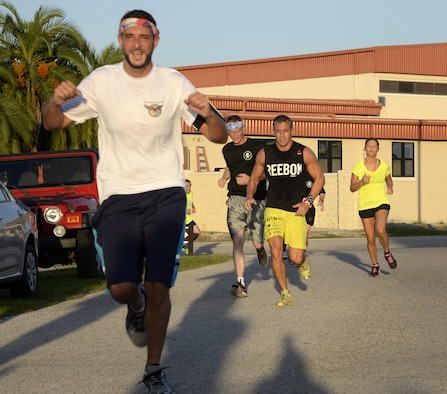 Members of Team MacDill race through the 9/11 Memorial 5K finish line at MacDill Air Force Base, Fla., Sept. 9, 2016. Approximately 180 personnel participated in the run which was in remembrance of the lives lost in the Sept. 11, 2001 terrorist attacks. (U.S. Air Force photo by Tech. Sgt. Krystie Martinez)