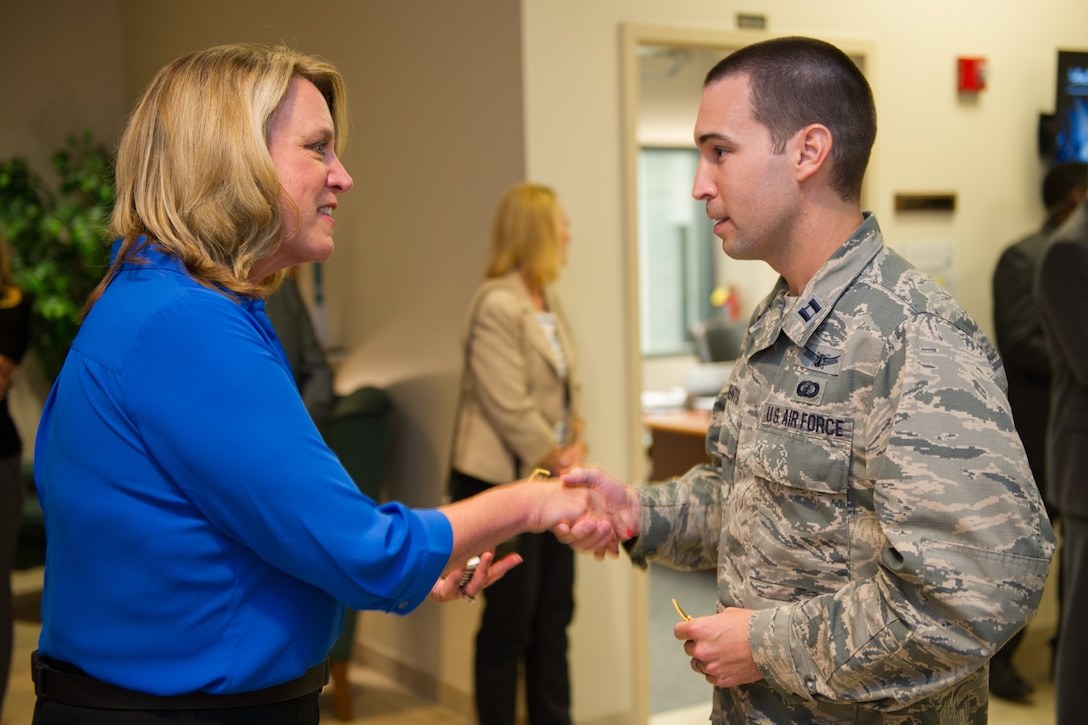 The Honorable Deborah Lee James Secretary of the Air Force receives a mission patch from Capt. Kyle Clements, 5th Space Launch Squadron, prior to the Atlas V launch Sept. 8, 2016, at Cape Canaveral Air Force Station, Fla.  (U.S. Air Force photo/Matthew Jurgens)