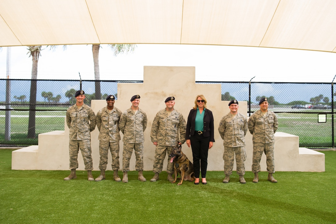 The Honorable Deborah Lee James Secretary of the Air Force poses for a photo with members of the 45th Security Force Squadron after a K-9 demonstration Sept. 9, 2016, at Patrick Air Force Base, Fla. Her two-day stay included an all call, meeting with members of Patrick-Cape and its mission partners, and a visit to the Atlas Spacecraft Operations Center where she witnessed her first launch at the Eastern Range. (U.S. Air Force photo/Matthew Jurgens)