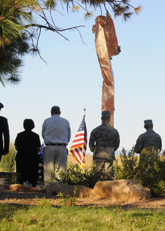 SCHRIEVER AIR FORCE BASE, Colo. — Members of Team Schriever gather to honor the 2,996 individuals who lost their lives in the Sept. 11, 2001 terror attacks at Schriever Air Force Base, Colorado, Sept. 09, 2016. A wreath was presented by Col. Anthony Mastalir, 50th Space Wing vice commander, and Geri Satterfield, 50th Space Wing protocol chief at the 9-11 artifact display. Don Addy, Chairman of the Colorado Thirty Group, donated the wreath to the base. Addy worked to secure the 9-11 artifacts at installations across the Front Range. (U.S. Air Force Photo/Staff Sgt. Matthew Coleman-Foster)