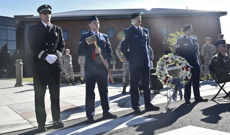 Members from Fairchild's 92nd Civil Engineer Squadron Fire Department and 92nd Security Forces Squadron stand during the Patriot's Day retreat ceremony Sept. 9, 2016, at Fairchild Air Force Base, Wash. The ceremony was held in remembrance of those who lost their lives in the Sept. 11, 2001 terrorist attacks. (U.S. Air Force photo/Airman 1st Class Taylor Shelton)