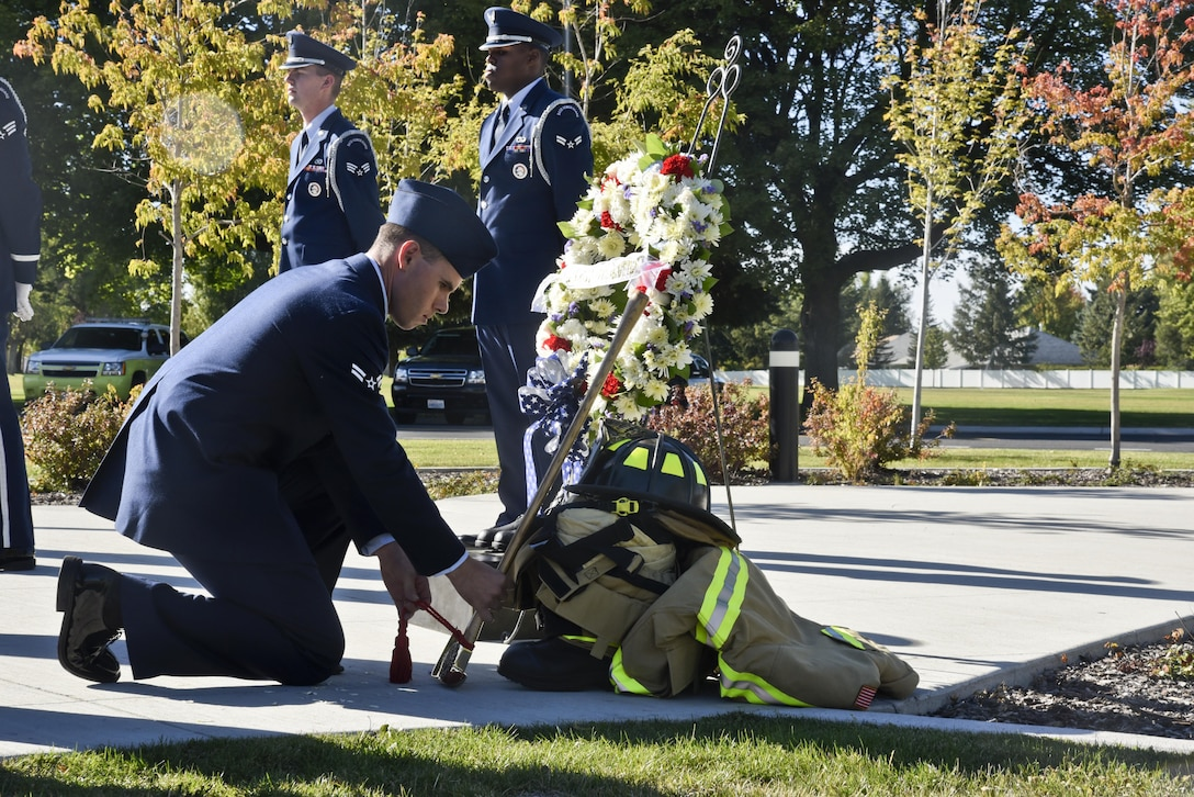"Airman 1st Class Shawn Mercer, 92nd Civil Engineer Squadron firefighter, places an axe on a display during the Patriot's Day retreat ceremony Sept. 9, 2016, at Fairchild Air Force Base, Wash. Sun. Sept. 11, 2016, marks the 15th anniversary of the deadliest terrorist attack on American soil. The attack was planned and executed by Islamic extremist organization, Al-Qaeda, and ultimately led to the ongoing ""Global War on Terrorism."" (U.S. Air Force photo/Airman 1st Class Taylor Shelton)"