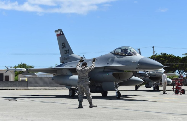 Tech. Sgt. Kevin Yamaguchi, a crew chief with the 149th Fighter Wing, Texas Air National Guard, headquartered at Joint Base San Antonio-Lackland, Texas, marshals an F-16 Fighting Falcon at Joint Base Pearl Harbor Hickam, Hawaii, Aug. 18, 2016. Yamaguchi participated in Sentry Aloha 2016, a large-scale fighter exercise hosted by the Hawaii Air National Guard (U.S. Air National Guard photo by Tech. Sgt. Rebekkah Jandron)