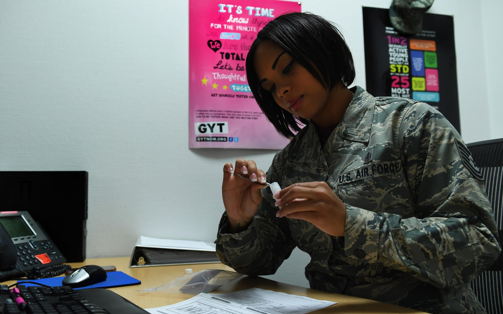 Technical Sergeant Jessica Roofe, 86th Aerospace Medicine Squadron NCO in charge of epidemiology, prepares tick to be sent for testing, September 9, 2016, at Ramstein Air Base, Germany (U.S. Air Force/Tryphena Mayhugh)