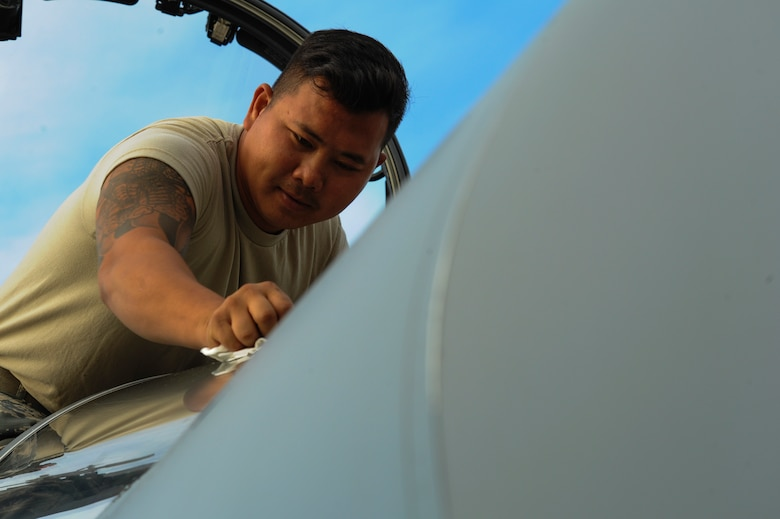 California Air National Guard Staff Sgt. Tee Xiong, a 194th Expeditionary Fighter Squadron crew chief, cleans the windshield of an F-15C Eagle fighter aircraft on the flightline at Graf Ignatievo, Bulgaria, Sept. 8, 2016. Four of the squadron's F-15Cs will conduct joint NATO air policing missions with the Bulgarian air force to police the host nation's sovereign airspace Sept. 9-16, 2016. The squadron forward deployed to Graf Ignatievo from Campia Turzii, Romania, where they serve on a theater security package deployment to Europe as a part of Operation Atlantic Resolve. (U.S. Air Force photo by Staff Sgt. Joe W. McFadden)