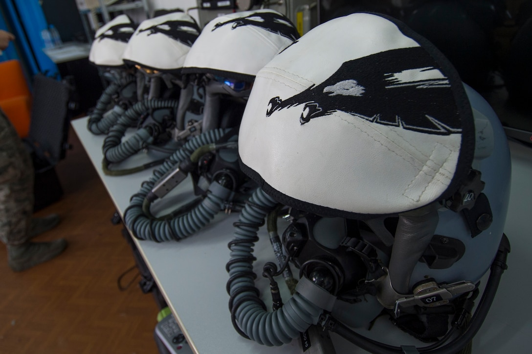 A collection of helmets belonging to California Air National Guard F-15C Eagle fighter aircraft pilots remain on a table at the 194th Expeditionary Fighter Squadron's flight operations room at Graf Ignatievo, Bulgaria, Sept. 8, 2016. Four of the squadron's F-15Cs will conduct joint NATO air policing missions with the Bulgarian air force to police the host nation's sovereign airspace Sept. 9-16, 2016. The squadron forward deployed to Graf Ignatievo from Campia Turzii, Romania, where they serve on a theater security package deployment to Europe as a part of Operation Atlantic Resolve. (U.S. Air Force photo by Staff Sgt. Joe W. McFadden)