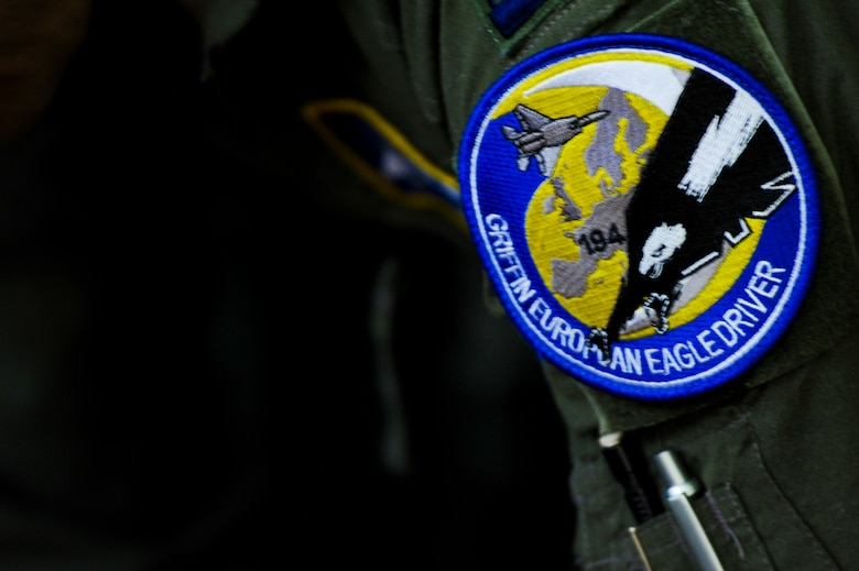 A 194th Expeditionary Fighter Squadron patch remains affixed to the flightsuit of a California Air National Guard F-15C Eagle fighter aircraft pilot inside the squadron's flight operations room at Graf Ignatievo, Bulgaria, Sept. 8, 2016. Four of the squadron's F-15Cs will conduct joint NATO air policing missions with the Bulgarian air force to police the host nation's sovereign airspace. The squadron forward deployed to Graf Ignatievo from Campia Turzii, Romania, where they serve on a theater security package deployment to Europe as a part of Operation Atlantic Resolve. (U.S. Air Force photo by Staff Sgt. Joe W. McFadden)