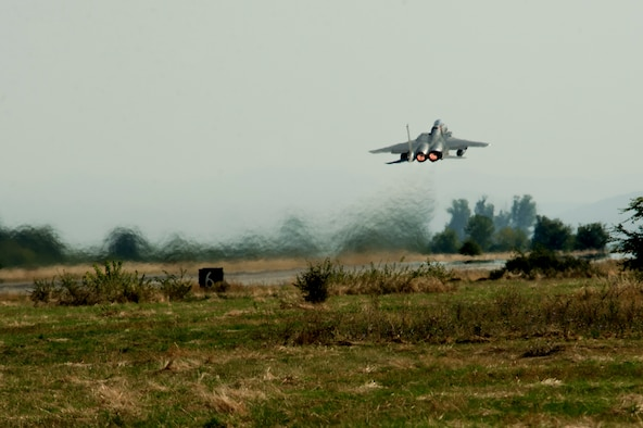 A California Air National Guard F-15C Eagle takes off from the flightline on Graf Ignatievo, Bulgaria, Sept. 8, 2016. Four of the 194th Expeditionary Fighter Squadron's F-15Cs will conduct joint NATO air policing missions with the Bulgarian air force to police the host nation's sovereign airspace Sept. 9-16, 2016. The squadron forward deployed to Graf Ignatievo from Campia Turzii, Romania, where they serve on a theater security package deployment to Europe as a part of Operation Atlantic Resolve. (U.S. Air Force photo by Staff Sgt. Joe W. McFadden)