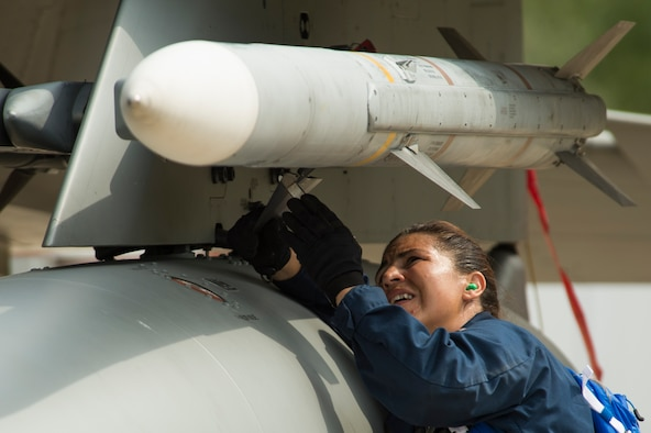 California Air National Guard Master Sgt. Audra Jimenez, a 194th Expeditionary Fighter Squadron weapons craftsman, affixes an AIM-120 advanced medium-range air-to-air missile onto an F-15C Eagle at Graf Ignatievo, Bulgaria, Sept. 8, 2016. The squadron forward deployed to Graf Ignatievo from Campia Turzii, Romania, in support of Operation Atlantic Resolve. (U.S. Air Force photo/Staff Sgt. Joe W. McFadden)