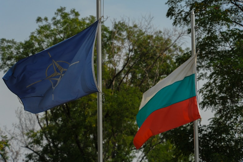 The NATO and Bulgarian flags fly inside the main entrance of Graf Ignatievo, Bulgaria, Sept. 9, 2016.  Four California and Massachusetts Air National Guards' F-15C Eagle fighter aircraft and approximately 75 Airmen from the 194th Expeditionary Fighter Squadron deployed to Graf Ignatievo, Bulgaria, and will stand ready as interceptors, prepared to quickly react to any violations and infringements for policing of Bulgarian airspace Sept. 9-16, 2016. The squadron forward deployed to Graf Ignatievo from Campia Turzii, Romania, where they serve on a theater security package deployment to Europe as a part of Operation Atlantic Resolve.  (U.S. Air Force photo by Staff Sgt. Joe W. McFadden/Released)