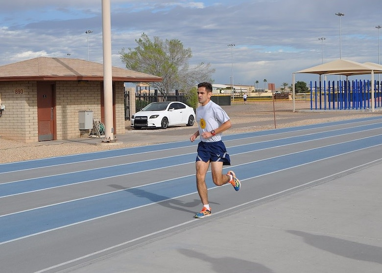 Staff Sgt. Christian Enriquez, 944th Fighter Wing Det. 1 Maintenance Squadron, F16 avionics craftsman ran into the Luke AFB history books earlier this year.  Running 1.5 miles in 8:10 minutes secured his success of beating the current record of 8:24 which was set at Luke on June 25, 2014. Originally from Chicago Ill., Enriquez began running 13 years ago as a freshman in high school and said it has always been something that he is good at. (U.S. Air Force photo by Tech. Sgt. Barbara Plante)