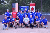 The American's softball team poses for a photo after winning the Western Air Defense Sector U.S. vs Canada Softball Challenge Cup Sept. 1 with a final score of 22 to 7.  Pictured from left to right are: (back row) Keven Blackwell, Nicholas Rhodes, Ian Crocker, Ryc Cyr, Kevin Weaver, David Bauld, Peter Hickam, Ryan McCray, and Michael Delaney.  (Front row) Carlos Gonzales, Allan Lawson, Joseph Landis, Daniel Rebstock, David Quelland, Robert Staszek, Michael Doing, and Jason Weczorek. (U.S. Air National Guard photo by Capt. Kimberly D. Burke)