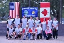 The Canadian Detachment softball team poses for a photo prior to the start of the Western Air Defense Sector U.S. vs Canada Softball Challenge Cup Sept. 1.  Pictured from left to right are: (back row)  Capt. Victor Choi, Major Brian Kynaston, Capt. Sean Anderson, Warrant Officer Gilles Turgeon, Capt. Barbara Steele, Corina Wappler, Chris Berkman, and Master Cpl. Brian Berkman. (Front row) Capt. Kenneth Mui, Major Marcelo Plada, Lt. Col. Matthew Wappler, Warrant Officer Richard Martin, Master Sgt. Gerald Sampson, and Kim Miller. (U.S. Air National Guard photo by Kimberly D. Burke)