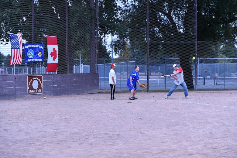 Canadian Detachment commander, Lt. Col. Matthew Wappler, hits a fly ball to left field during the Western Air Defense Sector U.S. vs Canada Softball Challenge Cup Sept. 1.  The U.S. won with a final score of 22 to 7. (U.S. Air National Guard photo by Capt. Kimberly D. Burke)