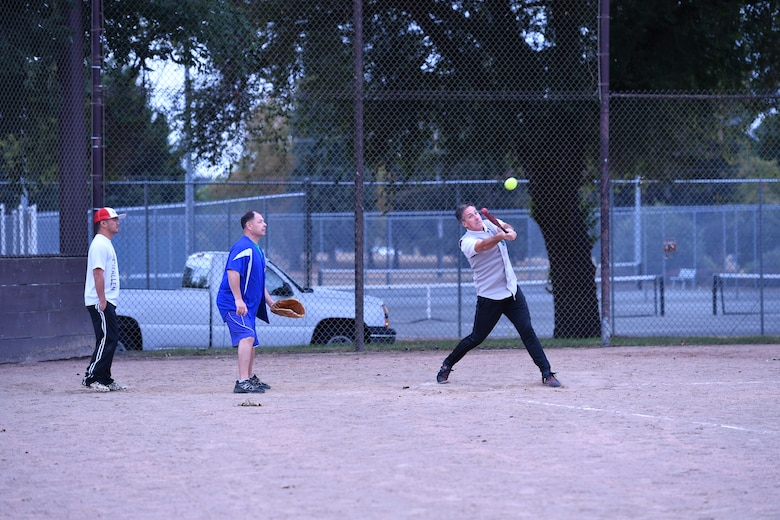 Canadian Warrant officer Gilles Turgeon hits a fly ball to center field during the Western Air Defense Sector U.S. vs Canada Softball Challenge Cup Sept. 1.  The U.S. won with a final score of 22 to 7. (U.S. Air National Guard photo by Capt. Kimberly D. Burke)