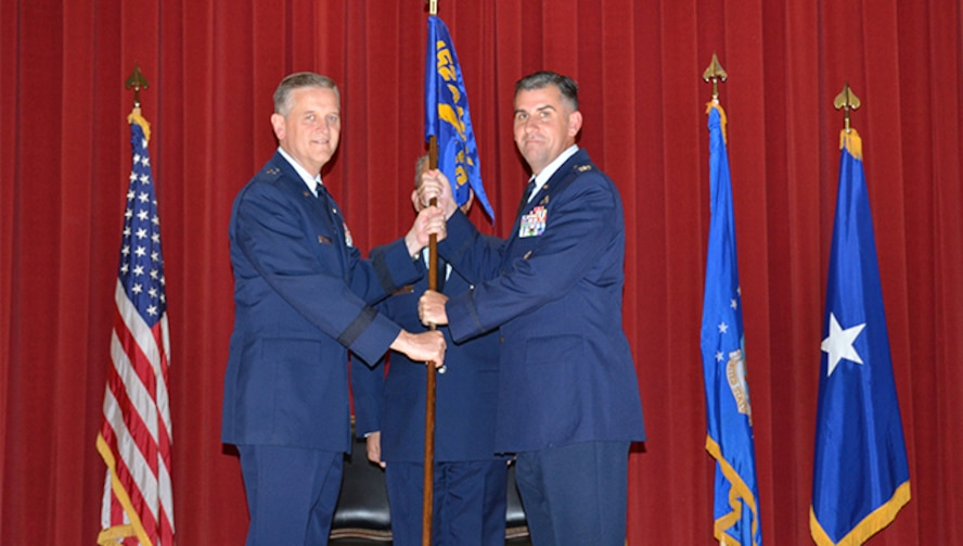 Col. James L. Hartle, right, receives the 452nd Maintenance Group guidon from Brig. Gen. Russell A. Muncy signifying the acceptance for his new role as commander of the 452nd MXG during his Assumption of Command Ceremony, held at the Cultural Resource Center, March Air Reserve Base, Aug. 7. The ceremony is a formal invocation of responsibility, authority, and accountability to the new commander. (U.S. Air Force photo/Senior Airman Joseph Dangidang)