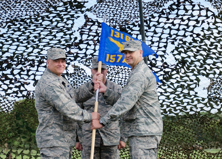 Col. Bill Boothman took command of the Missouri Air National Guard's 157th Air Operations Group during a change of command ceremony on the Parade Field at Jefferson Barracks, Missouri, Sept 10, 2016.  He is shown here accepting the guidon from 131st Bomb Wing commander, Col Ken Eaves.  (U.S. Air National Guard photo by Staff Sgt. Brittany Cannon)