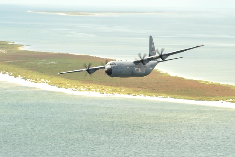 An 815th Airlift Squadron C-130J aircraft flies over the Mississippi Gulfcoast during a four-aircraft training mission Sept. 11, 2016. The aircraft took off from Keesler Air Force Base, Mississippi, and airdropped simulated cargo and heavy equipment over Stennis International Airport, Mississippi. (U.S. Air Force photo by Tech. Sgt. Ryan Labadens)