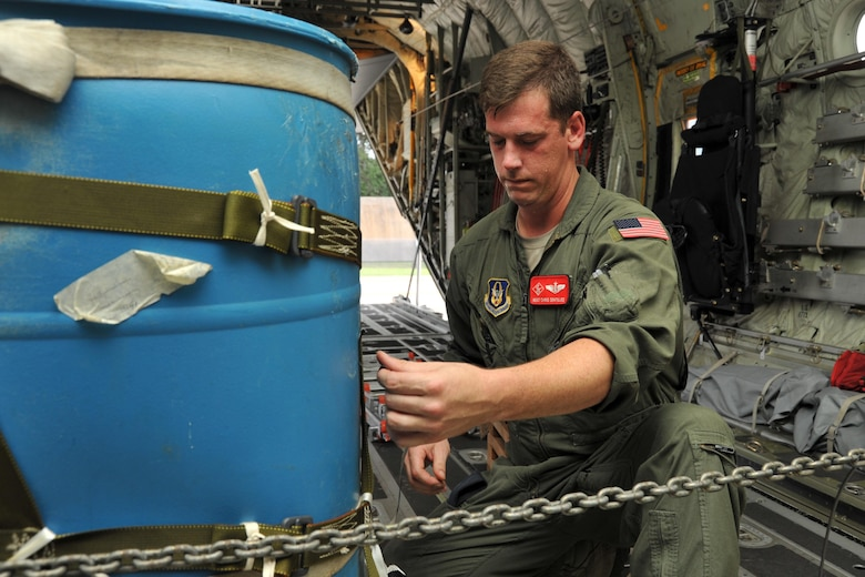 Master Sgt. Chris Sentilles, 815th Airlift Squadron loadmaster, secures a container delivery system on one of the squadron's C-130J aircraft that took part in a four-aircraft training mission Sept. 11, 2016, over the Mississippi Gulfcoast. The aircraft took off from Keesler Air Force Base, Mississippi, and airdropped simulated cargo and heavy equipment over Stennis International Airport, Mississippi. (U.S. Air Force photo/Tech. Sgt. Ryan Labadens)