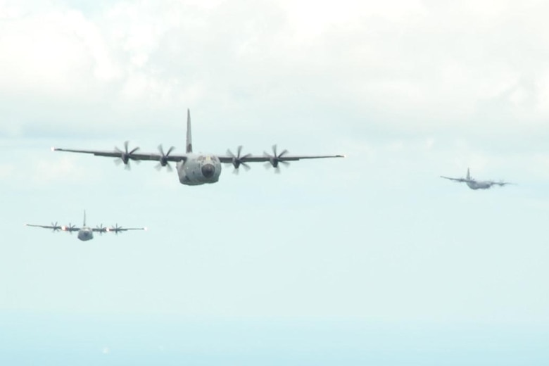 815th Airlift Squadron C-130J aircraft fly over the Mississippi Gulfcoast during a four-aircraft training mission Sept. 11, 2016. The aircraft took off from Keesler Air Force Base, Mississippi, and airdropped simulated cargo and heavy equipment over Stennis International Airport, Mississippi. (U.S. Air Force photo/Tech. Sgt. Ryan Labadens)