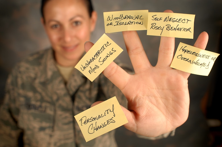 A member of the 111th Attack Wing, Horsham Air Guard Station, Pa., display the five signs that may mean someone is in emotional pain and might need help, Sept. 8, 2016. Guardsmen play a key role in spotting fellow service members at risk for suicide. (U.S. Air Force photo by Master Sgt. Chris Botzum)
