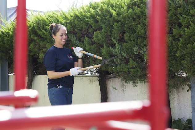 U.S. Navy Chief Petty Officer Dawn Gallegos, chief hospital corpsman with Marine Wing Support Squadron 171 at Marine Corps Air Station Iwakuni, trims bushes at Ekimae Hoikuen preschool in Iwakuni, Japan, Sept. 8, 2016. Sailors volunteered with the Marine Memorial Chapel to assist the school in completing required maintenance during an ongoing community relations project. (U.S. Marine Corps photo by Lance Cpl. Joseph Abrego)