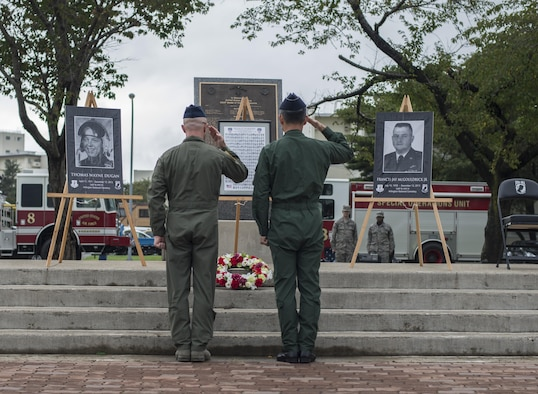 U.S. Air Force Col. R. Scott Jobe, left, 35th Fighter Wing commander, and Japan Air Self-Defense Force Maj. Gen. Koji Imaki, right, 3rd Air Wing commander, lay a wreath during the 2016 POW/MIA and 9/11 remembrance ceremony at Misawa Air Base, Japan, Sept. 9, 2016. The wreath was placed in honor of the 2,977 people from 91 countries who lost their lives during the 9/11 attacks. (U.S. Air Force photo by Senior Airman Brittany A. Chase)