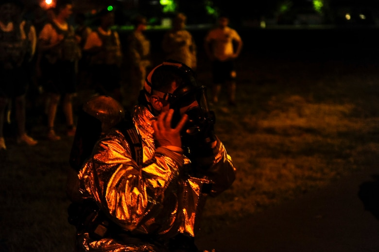 A U.S. Air Force firefighter from the 8th Civil Engineer Squadron puts on his mask before the start of the 9/11 memorial stair climb at Kunsan Air Base, Republic of Korea, Sept. 12, 2016. The 9/11 memorial stair climb event is a tribute to the 343 firefighters who gave their lives during the tragic events at the World Trade Center on September 11, 2001. (U.S. Air Force photo by Senior Airman Colville McFee/Released)