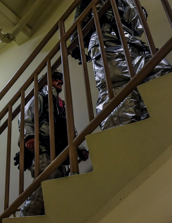U.S. Air Force firefighters from the 8th Civil Engineer Squadron climb up flights of stairs at Kunsan Air Base, Republic of Korea, Sept. 12, 2016. The 9/11 memorial stair climb event is a tribute to the 343 firefighters who gave their lives during the tragic events at the World Trade Center on September 11, 2001. (U.S. Air Force photo by Senior Airman Colville McFee/Released)