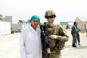 Army 2nd Lt. Eva Gibbons, assigned to the 3rd Cavalry Regiment, stands with Yassmin, her Afghan counterpart, during an advising engagement at the 202nd Police Zone Regional Training Center in Nangarhar province, Afghanistan, July 14, 2016. Yassmin is a doctor, and is currently the only female working at the RTC. Army photo by Capt. Grace Geiger