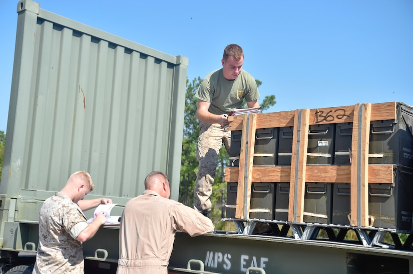 Marines from U.S. Marine Corps Base Quantico, Virginia, Detachment Charleston, inspect a pallet of munitions prior to storing it in a magazine, Sept 7, 2016, at Joint Base Charleston - Weapons Station, South Carolina. Before arriving at the JB Charleston-WS, the Sacagawea was prepositioned with more than 2,000 pallets of ordnance. The ship's mission is to sustain a Marine Corps expeditionary brigade for up to 30 days, enabling a quick response when needed. (U.S. Air Force Photo/Airman Megan Munoz)
