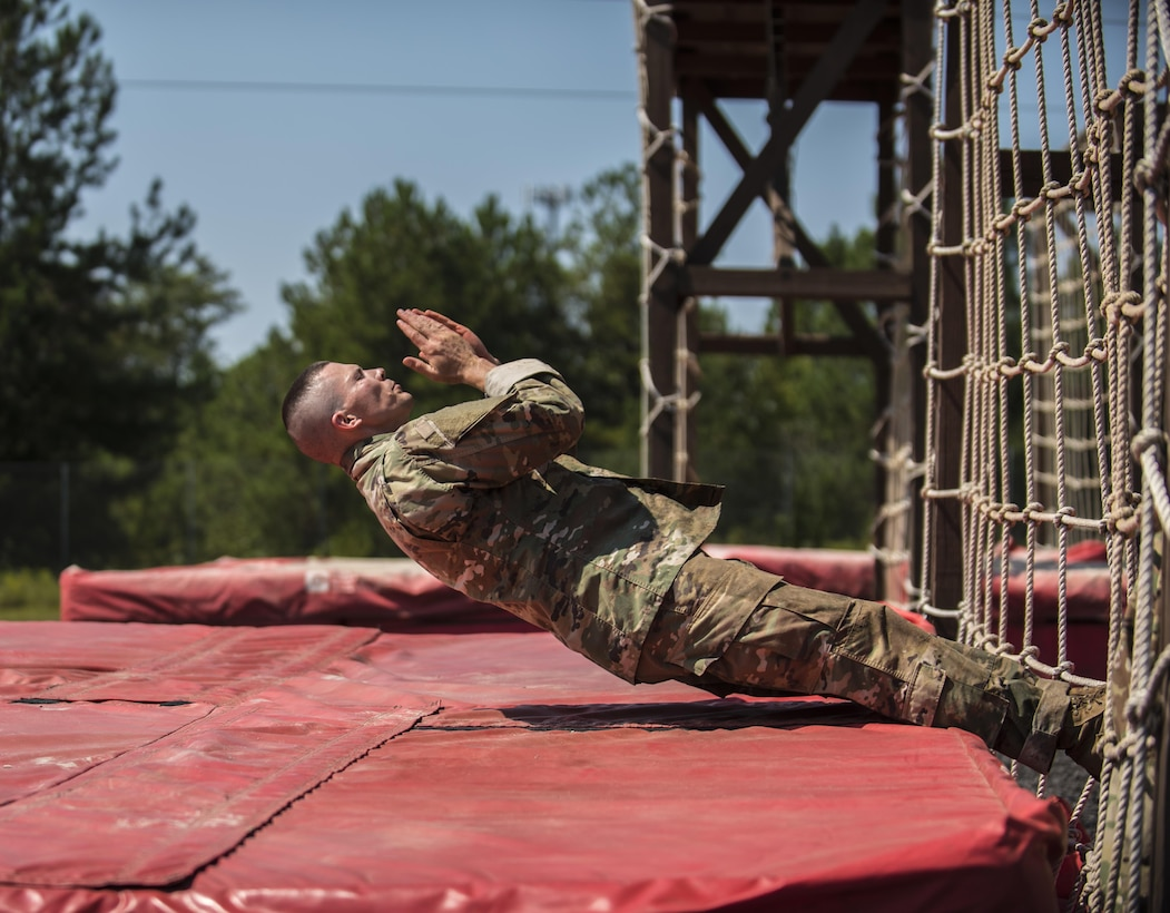 Army Reserve Drill Sergeant of the Year competitor, Sgt. 1st Class Jason Scott, 95th Training Division (IET), completes the cargo net obstacle on the fit to win obstacle course during the 2016 TRADOC Drill Sergeant of the Year competition, Sept. 8.  Scott and Sgt. Ryan Moldovan, 98th Training Division (IET), are facing off in a head to head competition at Fort Jackson, S.C., to see who will be named the 2016 Army Reserve Drill Sergeant of the Year.(U.S. Army Reserve photo by Sgt. 1st Class Brian Hamilton/ released)