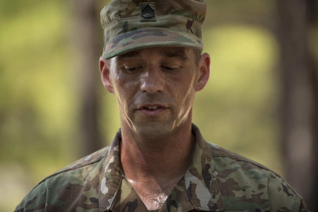 A competitor at the 2016 TRADOC Drill Sergeant and AIT Platoon Sergeant of the Year competion struggles to catch his breath before pitching a drill and ceremony module to trainees in Basic Combat Training, Sept. 8, at Fort Jackson, S.C. The Soldier had just completed the timed fit to win obstacle course. The competition runs Sept 6-9. (U.S. Army photo by Sgt. 1st Class Brian Hamilton/ released)