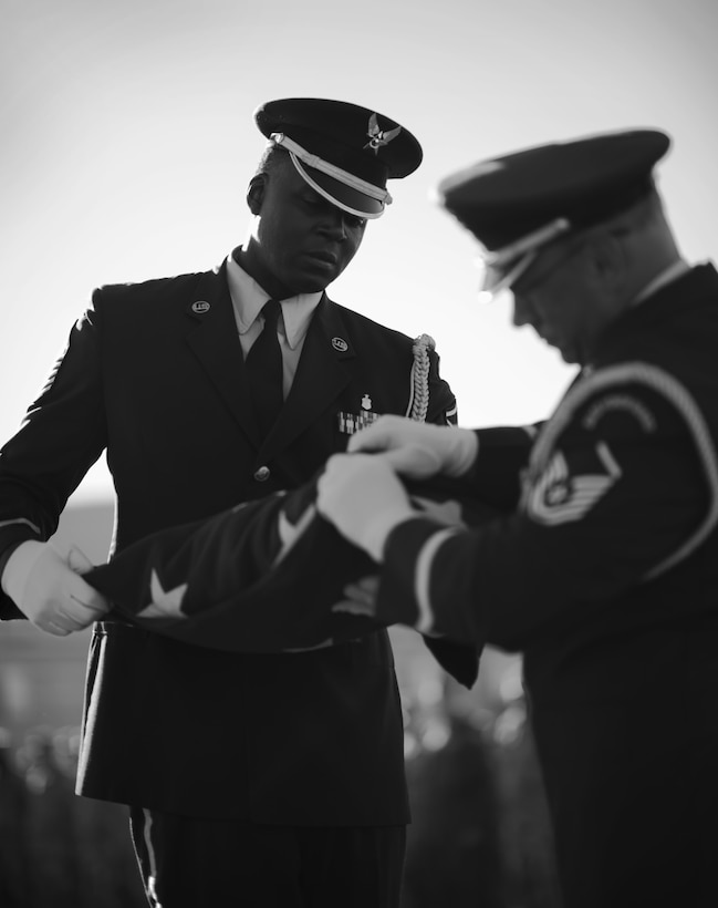 Base Honor Guard members Master Sgt. Jermell Motley and Master Sgt. Thomas Perreault complete the folding of the flag as part of a remembrance ceremony in honor of the victims of the 9/11 attacks on its 15 year anniversary, September 11, 2016, Niagara Falls Air Reserve Station, N.Y. (U.S. Air Force photo by Tech. Sgt. Steph Sawyer)