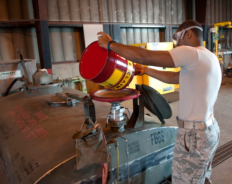 Senior Airman Jordan Smith, a fuels distribution operator with the 5th Logistics Readiness Squadron, pours fuel into a bowser lob at Minot Air Force Base, N.D., Aug. 31, 2016. This process takes place once the fuel has already been tested for reuse. (U.S. Air Force photo/Airman 1st Class Jonathan McElderry)