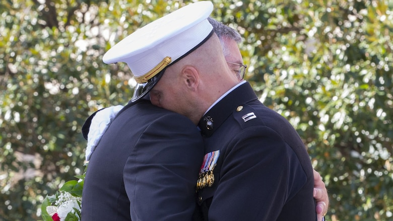Capt. Eric M. Montgomery hugs his father after receiving the wreath for his brother, Lance Cpl. Brian Montgomery, who was killed while in Haditha, Iraq in 2005, during a 9/11 Remembrance Ceremony in Nashville, Tenn., Sept 11, 2016. Marine Week Nashville is a chance to reconnect with our Marines, sailors, veterans and their families from different generations.