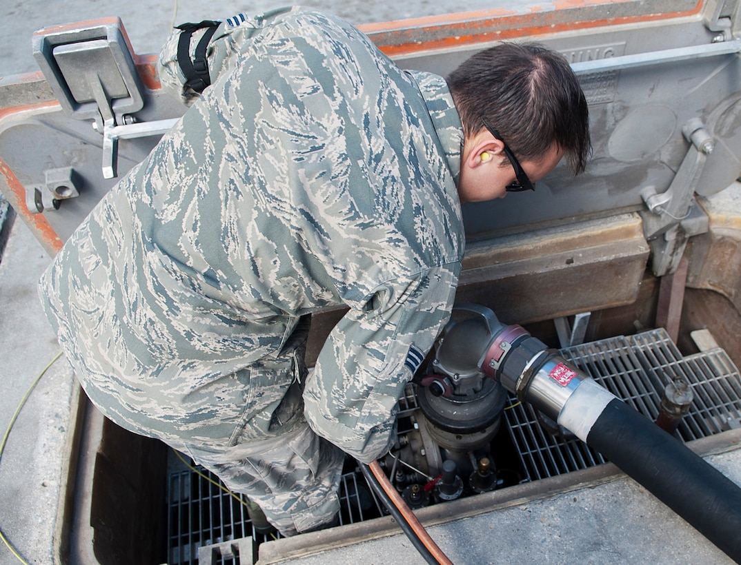 Senior Airman Samuel Fallot, a fuels operator with the 5th Logistics Readiness Squadron, removes a hose from a fuel pump on the flightline at Minot Air Force Base, N.D., Sept. 6, 2016. Using this fuel system, the fuel is pumped in a continuous loop in order for it to be successfully removed from the ground. (U.S. Air Force photo/Airman 1st Class Jonathan McElderry)