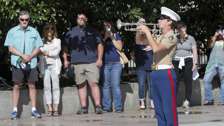 A member of the U.S. Marine Corps Band plays Taps during a 9/11 Remembrance Ceremony in Nashville, Tenn., Sept. 11, 2016. Marine Week Nashville is a chance to reconnect with our Marines, sailors, veterans and their families from different generations.