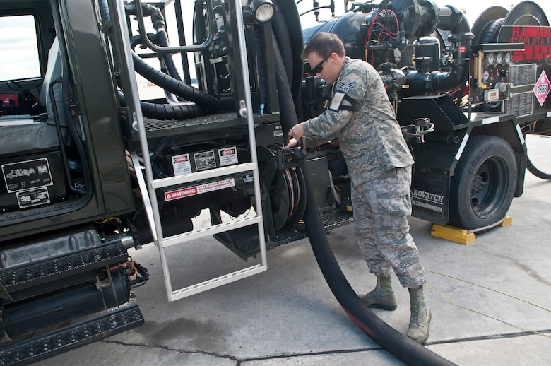 Senior Airman Samuel Fallot, a fuels operator with the 5th Logistics Readiness Squadron, puts away a hose on a refueling truck after refueling a B-52H Stratofortress at Minot Air Force Base, N.D., Sept. 6, 2016. Depending on their flight schedule, up to eight B-52H Stratofortresses are refueled daily. (U.S. Air Force photo/Airman 1st Class Jonathan McElderry)