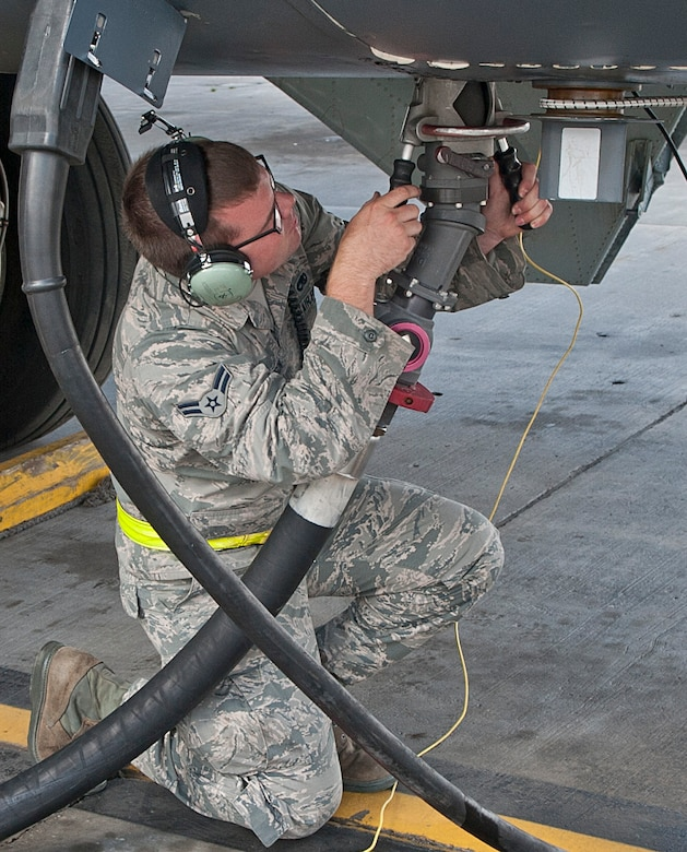 Airman 1st Class Sawyer Anderson, a member of the 5th Aircraft Maintenance Squadron, disconnects a single point hose from a B-52H Stratofortress on the flightline at Minot Air Force Base, N.D., Sept. 6, 2016. It takes approximately one hour to complete the refueling process for a B-52 using this fuel system, which pumps fuel from the ground in a continuous loop. (U.S. Air Force photo/Airman 1st Class Jonathan McElderry)