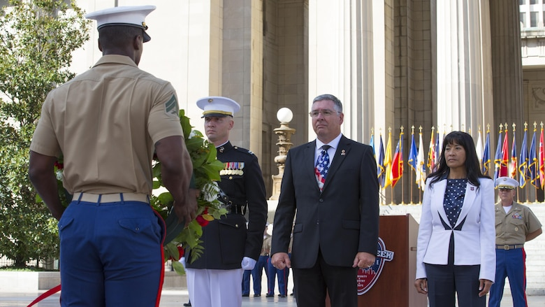 A Marine with Special Purpose Marine Air Ground Task Force – Nashville carries a wreath dedicated to Lance Cpl. Brian Montgomery, who was killed while in Haditha, Iraq in 2005, to Montgomery's father and brother during a 9/11 Remembrance Ceremony in Nashville, Tenn., Sept. 11, 2016. Marine Week Nashville is an opportunity to commemorate the unwavering support of the American people, and show the Marine Corps' continued dedication to protecting the citizens of this country.