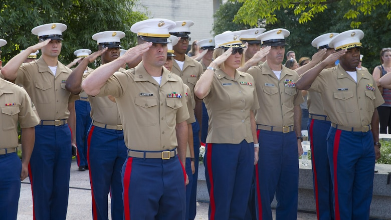 Marines with Special Purpose Marine Air Ground Task Force – Nashville salute during the playing of the National Anthem as part of a 9/11 Remembrance Ceremony in Nashville, Tenn., Sept. 11, 2016. Marine Week Nashville provides an opportunity for the Marine Corps to visit a city that normally doesn't have opportunities to interact with Marines on a regular basis.